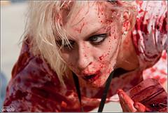 Recharged Zombie (eraut) Tags: girl female blood downtown earring sidewalk brains blonde undead bloody zombies eyeshadow highstreet guts columbusoh livingdead zombiegirl zombiewalk sigma70200mmf28 femalezombie eos400d canondigitalrebelxti dropofblood girlzombie vialofblood zombiewalk2010