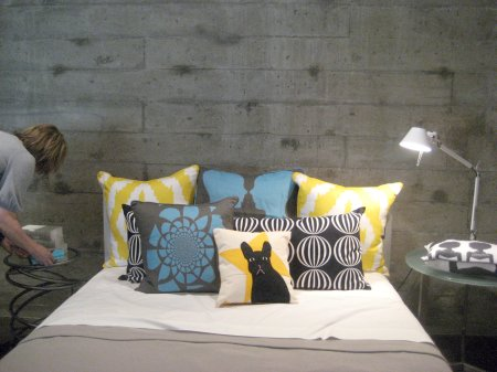 AphroChic Pillows on Bed