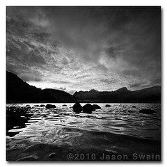 Back to Black (& white). Blea Tarn, Lake District. (s0ulsurfing) Tags: pictures uk blue light england sky blackandwhite bw cloud white mountain lake black mountains reflection english nature silhouette clouds composition contrast canon reflections walking landscape photography grey mono evening scenery rocks skies natural britain dusk hiking ominous district wide lakes picture wideangle monotone hills reflected photograph valley cumbria fells 7d april vista oily british ripples tarn landschaft silhouetted tranquil atmospheric foreground langdale cirrus 2010 treking langdales bleatarn 10mm sigma1020 s0ulsurfing vertorama canon7d