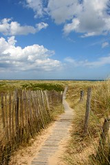 Norfolk dunes (Linda Cronin) Tags: sea sky beach clouds fence interestingness sand norfolk explore thumbsup blakeneypoint gamewinner challengeyouwinner mywinner 3waychallengewinner cywinner 15challengeswinner lindacronin flickrelite motifdchallengewinner photofaceoffwinner likeitornotwinner pregamesweepwinner