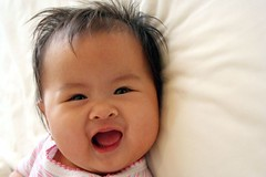 What a smile! (cmiguel) Tags: morning family pink portrait baby white inspiration color love girl smile kids wow mouth wonderful asian fun happy hotel interestingness bed eyes moments babies ultimate sweet stripes philippines joy daughter earlymorning cutie explore innocence expressive laughter capture bliss heavenly pleasure pinoy justwokeup irresistable abigfave cmiguel