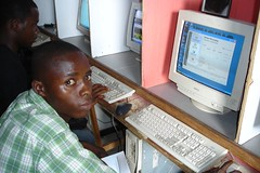 Tommy at the Internet Cafe in his village