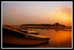 Sunset at Ravi (Naeem Rashid) Tags: pakistan sunset cloud nature clouds d50 river boats boat nikon searchthebest ravi punjab lahore naturesfinest