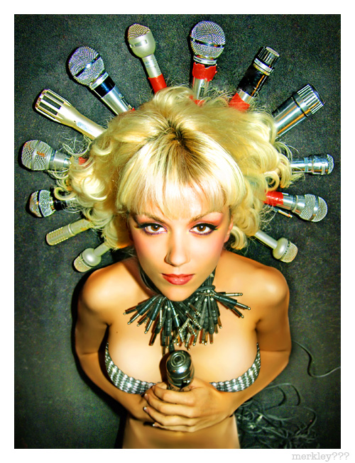 DJ Lea Luna - Posing On a Fake Halo of 13 Former Mormon Church Pulpit Microphones That Have Since Been Used To Record Songs About Pre-Marital Sex and Other Commandments Upon Which Many Have So Happily Trodden