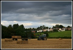 End of the Day... (Donna JW) Tags: england tractor clouds farmland gloucestershire superhero darkclouds balesofstraw 15challengeswinner englishfarmland collectingthebales herowinner