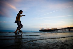 not something you see every day (lomokev) Tags: sunset sea summer sky man beach water silhouette canon eos pier brighton dusk low silhouettes unicycle 5d lowtide brightonpier canoneos5d ratseyeview  deletetag lowtidebikeride upcoming:event=62242 uniycycle file:name=img1236