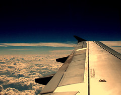 Flying on a  Jet Plane.. (.Andi.) Tags: travel sky clouds airplane wing perspective