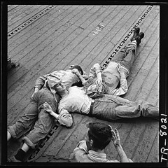Sailors sleeping on flight deck of the USS Lexington (CV-16)., 11/1943