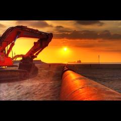 London 150 Miles Ahead (Dimitri Depaepe) Tags: sunset sun clouds sand bravo raw pentax oostende pipeline hdr bulldozer ostend orton peopleschoice blueribbonwinner magicdonkey instantfave anawesomeshot holidaysvancanzeurlaub bratanesque