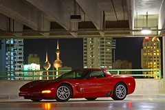 Corvette Z06 at night (A.alFoudry) Tags: park light red black car sport night canon eos lights is parking tripod towers lot full motors frame 5d motor kuwait usm fullframe  corvette ef kuwaiti q8 z06 70200mm abdullah   zo6 canoneos5d  f28l kuw vwc q80 canonef70200mmf28lisusm  xnuzha alfoudry  abdullahalfoudry foudryphotocom  kvwc kuwaitvoluntaryworkcenter  kuwaitvwc