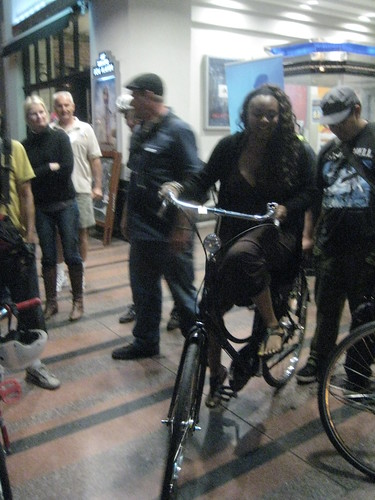 A woman riding a Batavus Old Dutch at a screening of Riding Bikes with the Dutch.