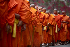 Eye Contact (pearson_251) Tags: morning dawn nikon religion monks ritual procession laos buddah buddist luangprabang robes alms d80 twtmeiconoftheday