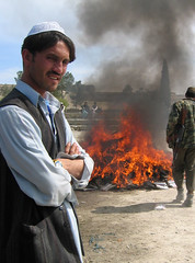 Hashish Fire (SmileDarling) Tags: afghanistan man soldier fire smoke muslim pit afghan frown marijuana hash kabul ak47 hashish bagram oef operationenduringfreedom khowst campvance victoriavillalobos chapmanairfield