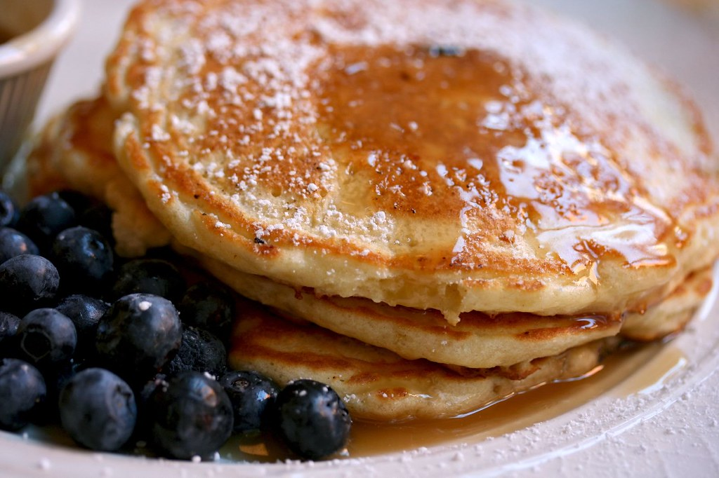 Blueberry Pancakes drizzled with maple butter