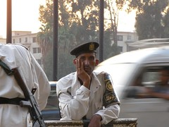 reflection (workinL8) Tags: portrait man face traffic personality cairo egyptian adults policeman