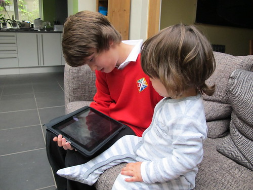 Two boys and an iPad by Ant McNeill.