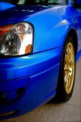 Bluebaru (bluejetjane) Tags: auto blue light 2004 car wheel lights automobile tire subaru hood headlight windshield rex impreza wrx scooby scoob subie hoodscoop goldwheels rallyblue worldcars