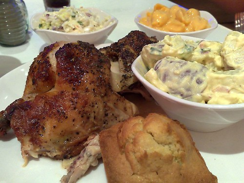 Clockwise from left: half chicken, cole slaw, macaroni and cheese, potato salad, and corn bread