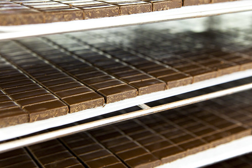 Trays upon trays of chopped ganache cooling in one of the refrigerator rooms