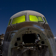 Patinateer (Lost America) Tags: lightpainting night airplane aircraft cockpit fullmoon boneyard airliner dc7 aviationwarehouse propliner douglasdc7