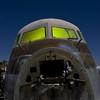 Patinateer (Lost America) Tags: lightpainting night airplane aircraft cockpit fullmoon boneyard airliner dc7 aviationwarehouse propliner douglasdc7