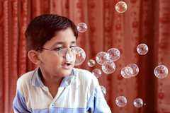 Worry-Free Age (AHMED...) Tags: pakistan red smile smiling kid availablelight naturallight bubbles son ahmed sind abdul sindh muhammad haseeb supershot mehrabpur