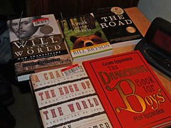 books eyeglasses nightstand theroad awalkinthewoods readingmaterial thedangerousbookforboys willintheworld acrackintheedgeoftheworld