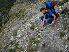 Sean shows off the scat. (matt semel) Tags: montana sean glaciernationalpark holeinthewall bearscat