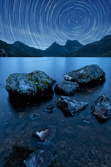 Vincent (Starry Starry Night) (Tim Poulton) Tags: longexposure travel blue light sun moon lake mountains ice nature water beautiful night clouds trekking reflections stars landscape mono amazing aperture nikon rocks artist fineart australia panoramic clear tasmania stacking starry cloudscape solarsystem shutterspeed 18mm cradlemountain vincentvangogh carlzeiss startrail poulton d3x flickraward