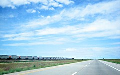 interstate and train (eioua) Tags: street sky clouds rural train canon colorado driving scenic bluesky powershot sd400 interstate plains i76 converginglines