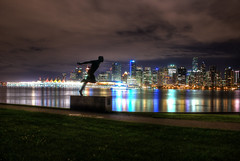 Vancouver behind Henry Jerome (HDR) (Brandon Godfrey) Tags: world pictures park city light sky urban canada water beautiful grass silhouette statue skyline night vancouver clouds buildings reflections landscape photography lights harbor amazing scenery long exposure downtown cityscape bc pacific northwest metro photos harbour pics earth path britishcolumbia sony scene columbia canadian shangrila pacificnorthwest northamerica metropolis british stanleypark seawalk coal dslr canadaplace hdr highdynamicrange harbourcentre lowermainland a300 shawtower photomatix tonemapped henryjerome tonmapping thechallengegame challengegamewinner fairmontpacificrim