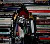 What is it about me, books and cameras (Moochin Photoman) Tags: me fantastic inspired fujifilmf10 wishidthoughtofit polaroid1200si everydayorange moochinphotoman finetta ensignselfix1220 djahrememberfilm themoochinmachinehaspuncturesnotonebuttwoofthefeckers eos3with24mf28 selfportraitafterafashion rootsmaninthebackground fertilegroundindeed tidyingupmyballax morefeckinmessnaarthanwhenistarted stillifoundacoupleofbooksthatihadntseeninawhile mariogiacomelliisagenius talkaboutcheeky smugglingboozeandfegsintoaseminarysellingitthenretireingtotherooftophotographthedancingpriestsinthesnow nowaitidhavehadtoenrole feckthatshit hadalaughwiththisbutigottagettidying anyonewouldthinkigotnothinbettertodo