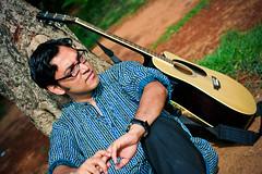 Singer who designs circuits | Anupam (@k@sh) Tags: morning portrait hot canon 350d rocks texas famous bangalore environmental sunny places singer portfolio karnataka gitar anupam bengali akash bengaluru