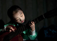 Chongjin little guitarist - North Korea (Eric Lafforgue) Tags: shadow musician girl children kid hands bravo war asia play hand guitar main korea asie coree fille guitarist northkorea guitare dprk coreadelnorte guitariste nordkorea 0466    coreadelnord   insidenorthkorea  rpdc  chongjin kimjongun coreiadonorte