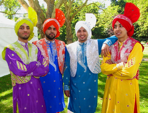 Sawan Mela South Asian Summer Festival, four Indian young men in traditional men's wedding clothes