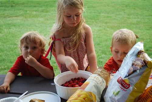Kids hanging out by the berries