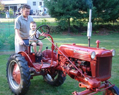 Mason driving Papa Tom's tractor
