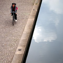 cycling (Cosimo Matteini (PC virus ridden. Off for a while)) Tags: people cloud reflection london bicycle pen canal cyclist candid olympus explore paddington londontransportmuseum epl1 cosimomatteini