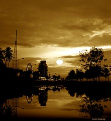 For your eyes only.... (aroon_kalandy) Tags: city light sunset sea urban sun india reflection tower beach nature beauty yellow photoshop buildings landscape creativity evening boat cityscape adobephotoshop artistic sony awesome kerala fantasy greatshot impressions concept lovely giantwheel naturelovers calicut kozhikode sihloutte urbansunset supershot topshots beautifulshot anawesomeshot photoscape malayalikkoottam sonyh50 aroonkalandy