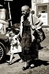Grandmother (GavinZ) Tags: street travel people bw italy woman rome girl monochrome blackwhite grandmother walk