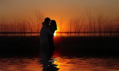 Isn't it RohMantic? (Ms Ladyred) Tags: two sun reflection love water happy bravo kiss couple awesome romance romantic magicdonkey abigfave superaplus aplusphoto superbmasterpiece infinestyle superhearts crimsonstudios