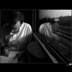 Back On The Train - The Pencil (Osvaldo_Zoom) Tags: travel light bw italy reflection train pencil writing canon hand journey commuter calabria trenitalia g7