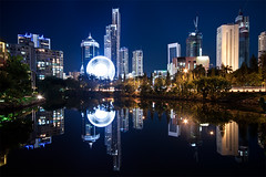 view on ferry's wheel in gold coast city (Pawel Papis Photography) Tags: city blue light reflection building tree water wheel ferry night river circle gold coast high view crane hilton australia palm clear explore soul rise frontpage cavill