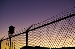 Tower (Tim Regan) Tags: fence watertower barbedwire watertowerfence