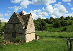 Naunton Dovecote (flash of light) Tags: summer england sky english clouds geotagged village cotswolds gloucestershire 2007 dovecote naunton geo:lat=51908946 geo:lon=1833201