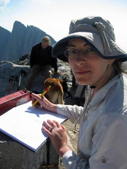 Kate signing the visitors register at Skolio