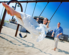 Ken and Nadia: A Swinging Scene (Ryan Brenizer) Tags: wedding usa ny newyork love beach topf25 beautiful smile work fun happy groom bride pretty fuji action july noflash longisland laugh oceanbeach 1755mmf28g fireisland formals 2007 s5pro