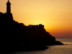 Faro al tramonto - by Renzo Ferrante