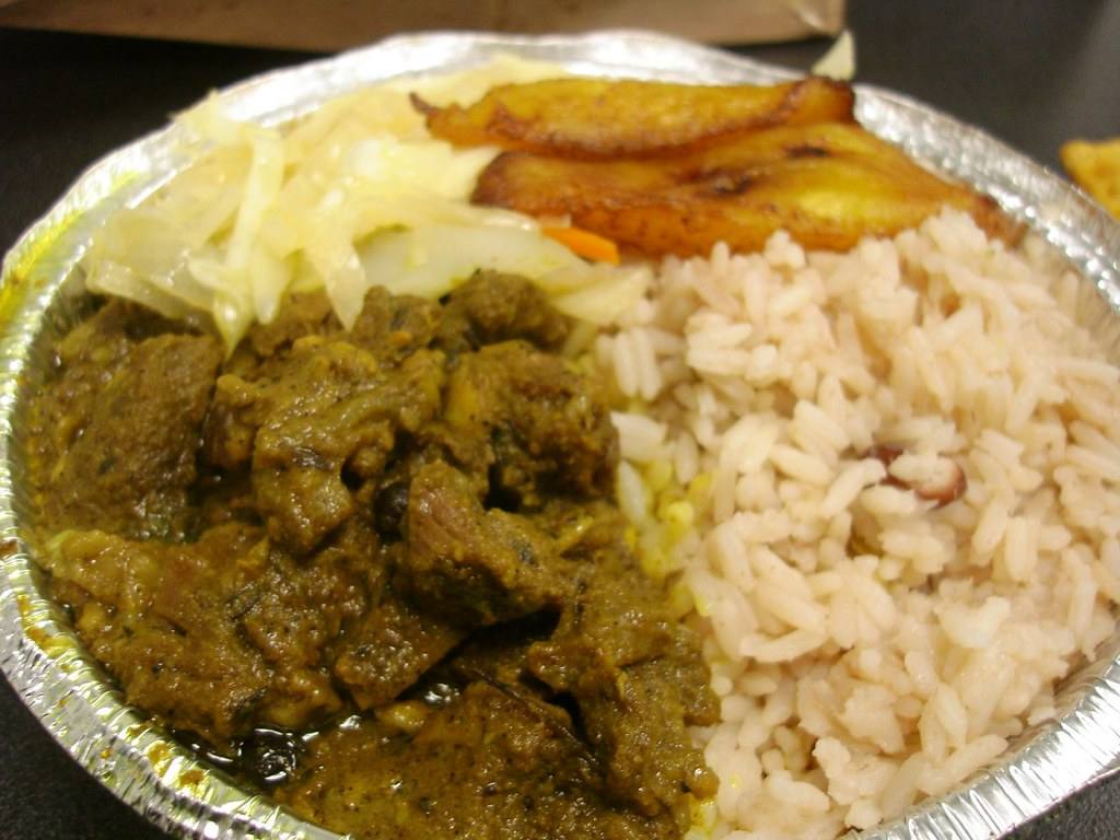 Curried Goat w/ Rice, Steamed Cabbage & Plantains