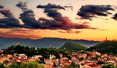 Trimontium in Latin, and Plovdiv in the beauty-language... (Emilofero) Tags: city houses sunset red sky orange building green tower history church beauty yellow architecture night clouds montagne dark town europe hill roots mosque clocktower bulgaria balkans turkish plovdiv b